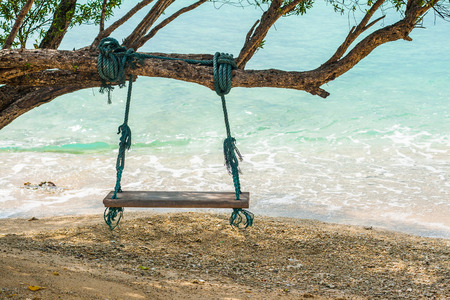 Wood swing on the beach under the tree