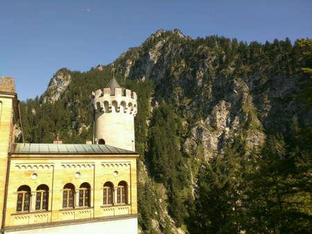 neuschwanstein: Neuschwanstein Castle on Bavaria Mountain background Stock Photo