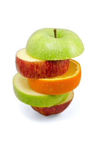 Apple and orange slices isolated on white background