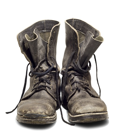 combat boots: Old and dirty military boots isolated on white background Stock Photo