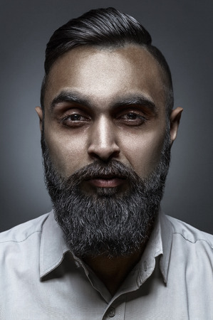 haircut: High fashion style portrait of bearded man with awesome haircut, esquire style