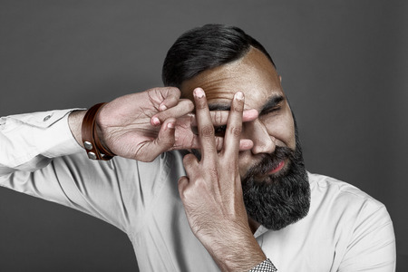 highfashion: High-fashion bearded man portrait with crossed fingers, esquire style
