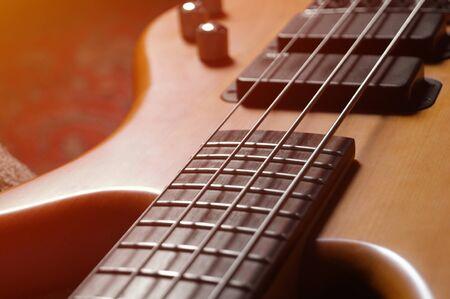 4-string vintage bass guitar background - high-res picture Standard-Bild