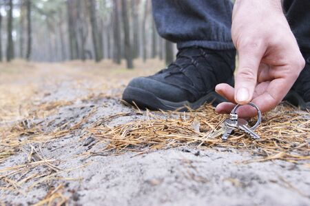 Finding a bunch of keys on a forest path when a man walked through the forest. Stok Fotoğraf