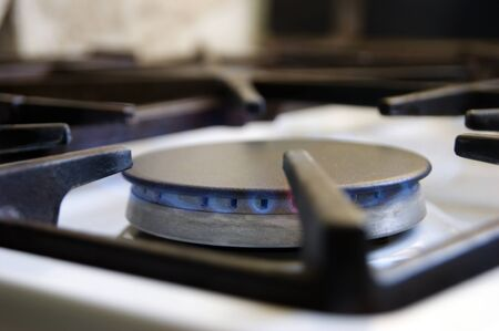 Kitchen gas stove with low burning propane gas. Conception of bad gas in apartments