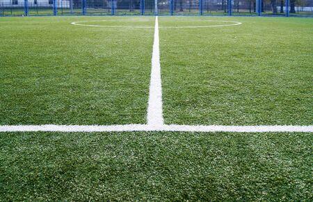 Artificial turf football field in park.