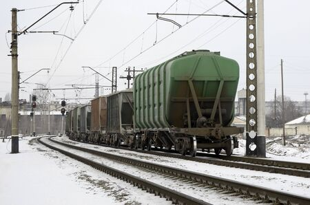 railroad hopper cars parked on rural tracks all by themselves on a cold winter day. Zdjęcie Seryjne