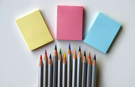 Three blank stickers and colorful pencils. Place for text. Copy space.