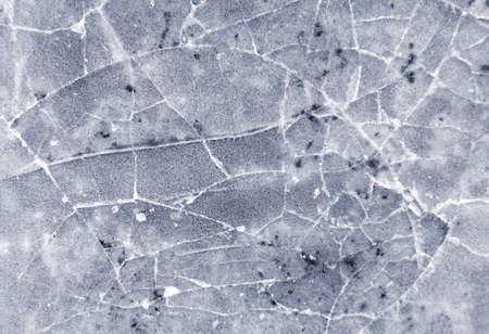 Frozen puddle with broken ice. Winter season. Archivio Fotografico