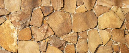 Light brown stone texture. Stone wall grunge background. Modern architecture, granite structure. Cement construction material