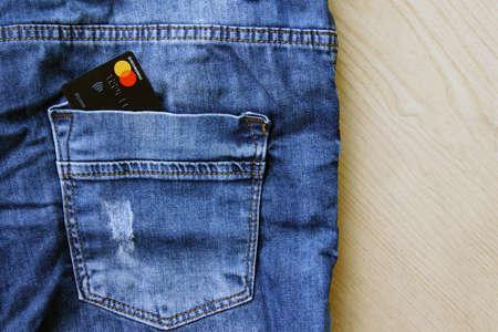 KHARKOV, UKRAINE - FEBRUARY 19, 2020: Credit Card Master Card in the back pocket of jeans.