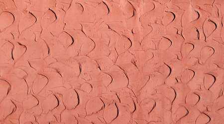 Coral clay plaster walls, for use as a background and texture.