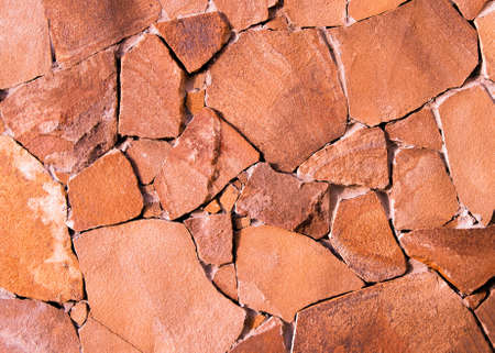 Red stone texture. Stone wall grunge background. Modern architecture, granite structure. Cement construction material