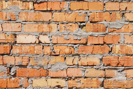 Old brick wall, old texture of red stone blocks closeup. Texture.