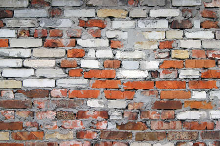 Red and white old brick wall background, abstract architecture pattern. Old Urban street. Building's facade.