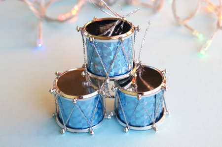 Christmas decoration for the Christmas tree in the form of drums on a blue background.