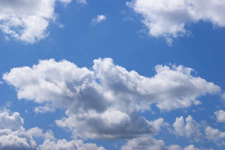 Light blue sky background with clouds. Summer cloudscape, beautiful weather background.