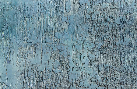 Texture of blue ribby stucco on cement wall. Abstract blue background. Concrete wall trim.