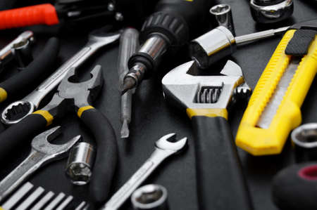 Many different tools for repair work on a black background. Repair and construction concept. Banco de Imagens