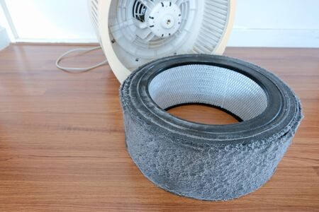 The Air purifier. Replace the filter of air purifier. Filter have a lot of dust. Dirty air filter need to maintenance.