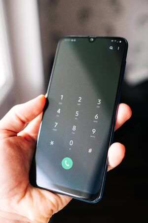 Samsung male hand with call number on screen. view from above Stock fotó