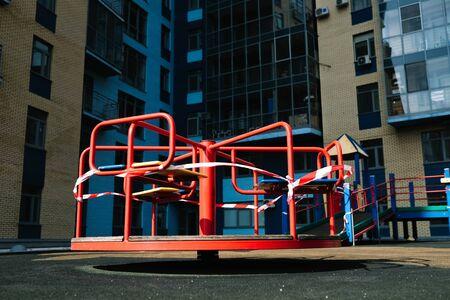 An empty playground for children in the yard. Fenced territory, coronavirus