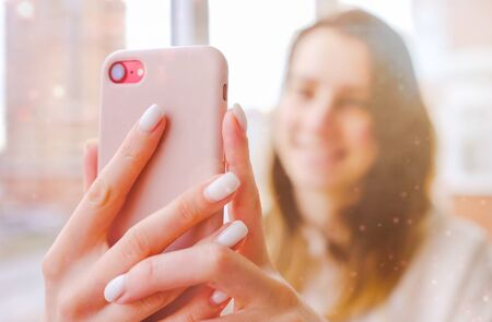 Happy woman laughing having online video call with friends or family smartphone