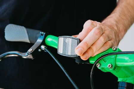 Installation of a front reflective green fix bike with white tires