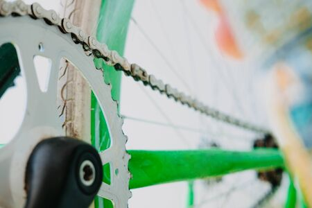 grease spray chain white green fix bike. Close-up. Side view