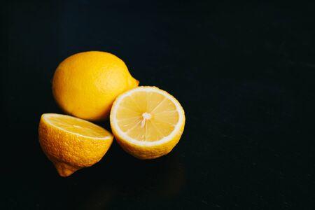 fresh lemon on black background. two lemons.