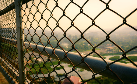 Wire cage at a walkway and mountain view. 版權商用圖片