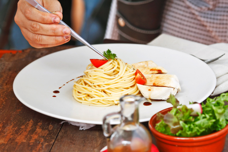 set up: Food stylist set up chicken spaghetti recipe for food photography Stock Photo
