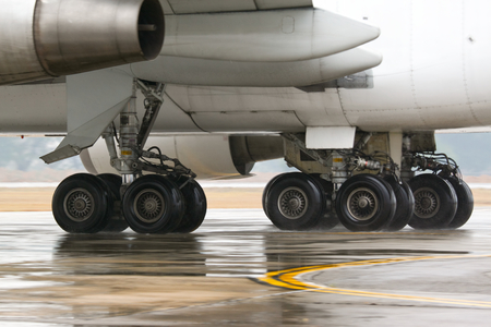 jumbo jet: Commercial jumbo jet airplane taxiing on taxiway under the rain