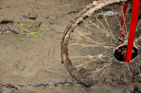 slovenly: bicycle wheel in mud