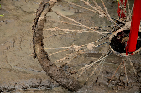 scrambling: bicycle wheel in mud