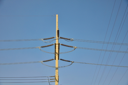 electricity pole: voltage electricity pole with blue clear sky background