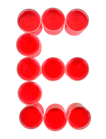 e ink: One letter of the alphabet. red drink in a glass