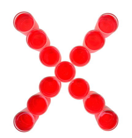 liquid x: One letter of the alphabet. red drink in a glass