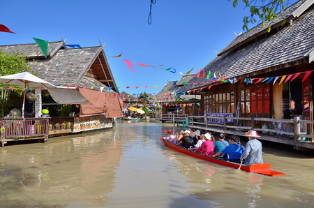 Pattaya, Thailand - August 19,2013:Travel and shopping in Pattaya Floating Market four regions Where have traditional commercial boats and villagers do about traditional foods and souvenirs.THAILAND