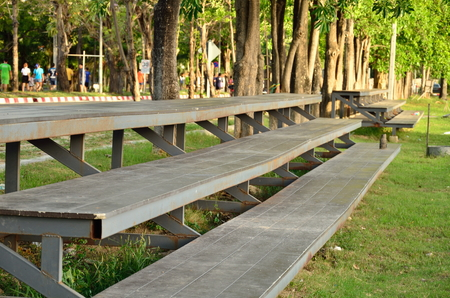 a set of old wooden bleachers for cheering on a sporting event at a local high school