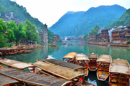 HUNAN, CHINA - JUNE 16, 2014 : Old houses in Fenghuang county in Hunan, China. The ancient town of Fenghuang was added to the UNESCO World Heritage Tentative List in the Cultural category.