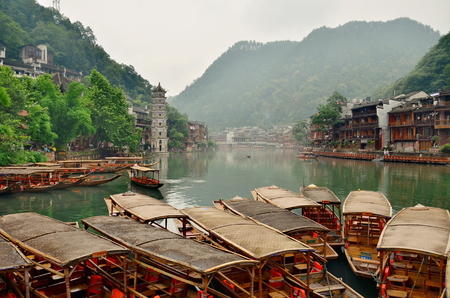 tentative: HUNAN, CHINA - JUNE 16, 2014 : Old houses in Fenghuang county in Hunan, China. The ancient town of Fenghuang was added to the UNESCO World Heritage Tentative List in the Cultural category.