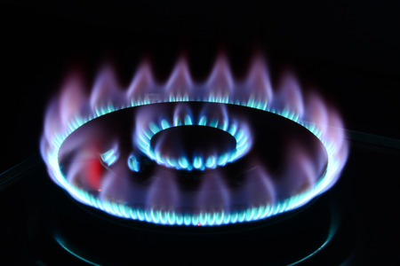 blue flame: The blue flame of a cooker burner in the dark
