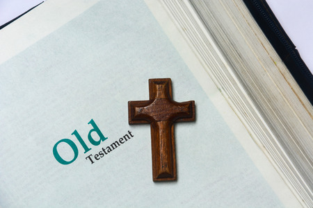 Old testament cover in Holy Bible with a wooden cross Stock Photo