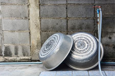 aluminium background: old aluminium basin with concrete background