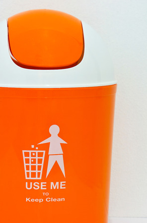 keep clean: orange bin with text on white background Stock Photo