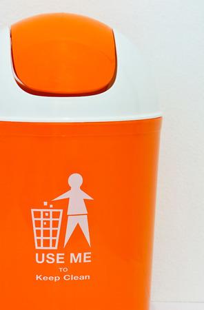 segregate: orange bin with text on white background Stock Photo