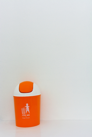 segregate: orange bin with text on white background, copy space