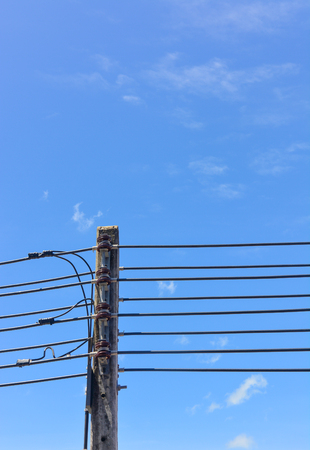 Electrical poles in white cloud and blue sky