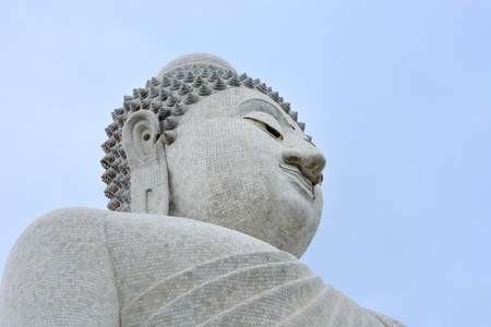 big white mable buddha with cloudy sky background, copy space, Phuket, Thailand Stock Photo